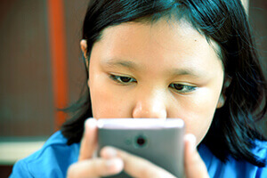 Child using a mobile device