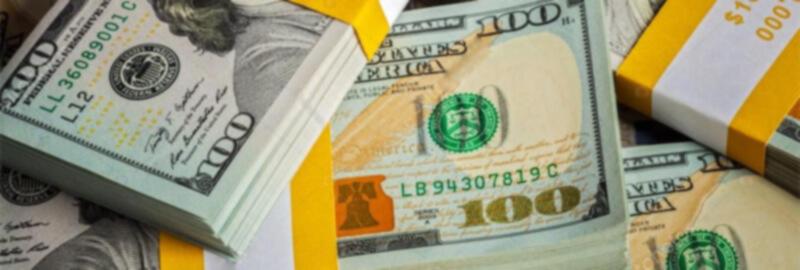 Bundles of $100 bills.