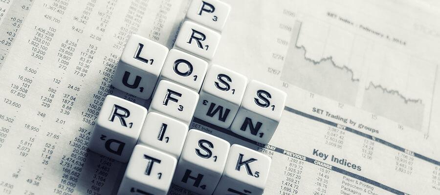 Profit, Loss, Risk - dice on newspaper.