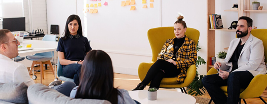 Group of business people in a branding meeting.