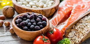 Healthy foods including nuts, blueberries, pluses and oily fish