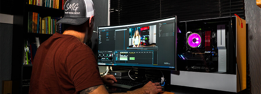 Man working in a video editing studio.