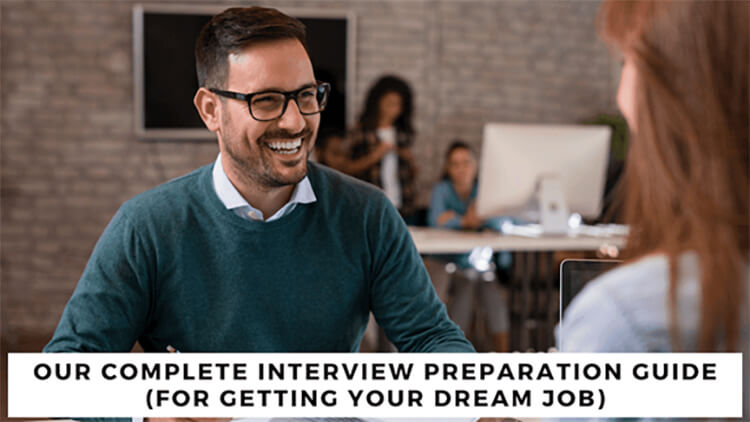 Male interviewer smiling with the caption. 'Our Complete Interview Preparation Guide (For Getting Your Dearm Job)''