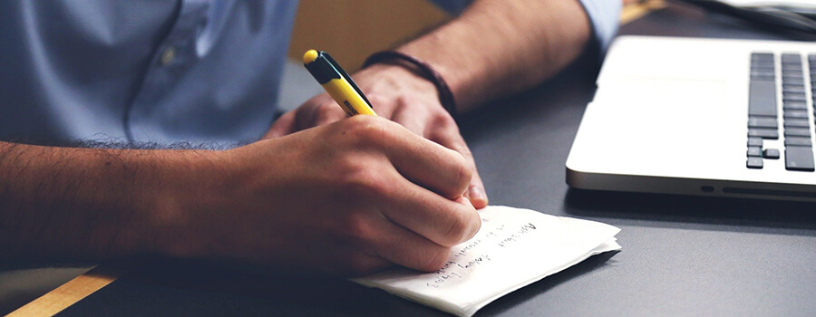 Man making notes in a notebook.