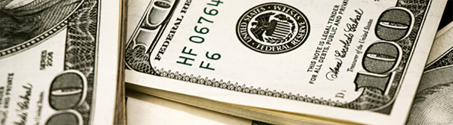Piles of $100 bills.