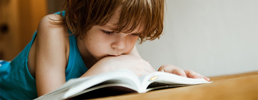 Close up of child reading.