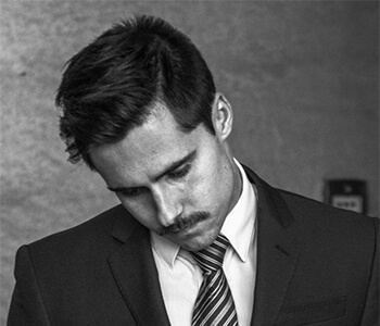 Man in a suit looking sad.