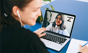 Woman making a video call on a laptop.