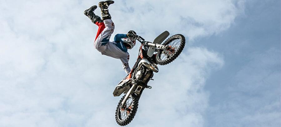 Stuntman jumping on a motorbike.