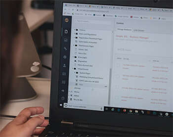 Laptop showing software to track files and documents.